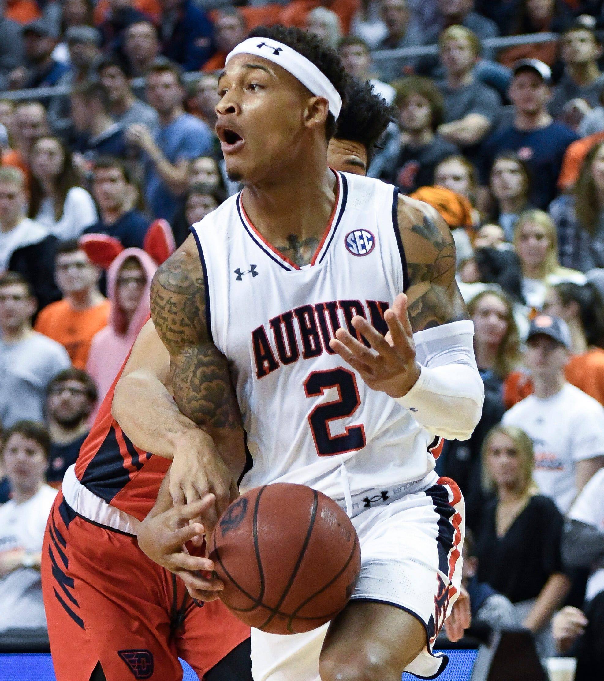 Brown's 34 points leads No. 8 Auburn past Dayton 82-72