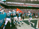Relive some of the top moments of NFL Week 13, including a miracle play by the Dolphins to beat the Patriots.