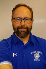 Barron Collier swimming coach Matt Nelson, the Naples Daily News Coach of the Year.