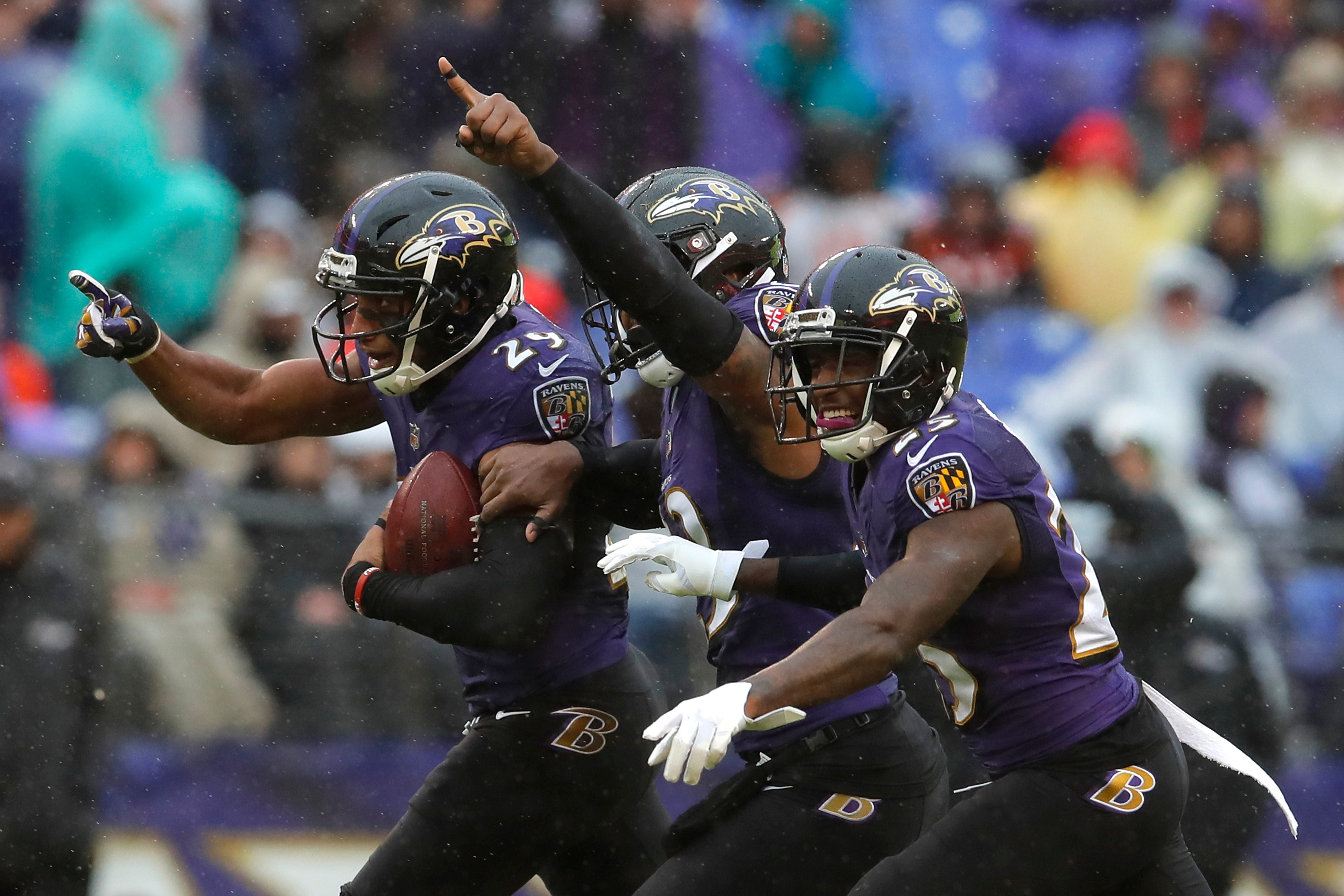 Ravens use running game, defense and ball control to win