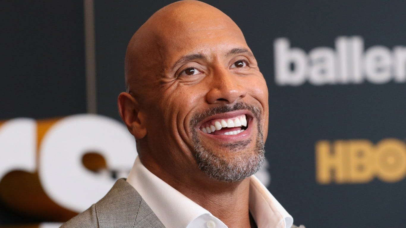 Dwayne Johnson shares sweet hug with daughters before 'daddy's arms is the last place they want to be'