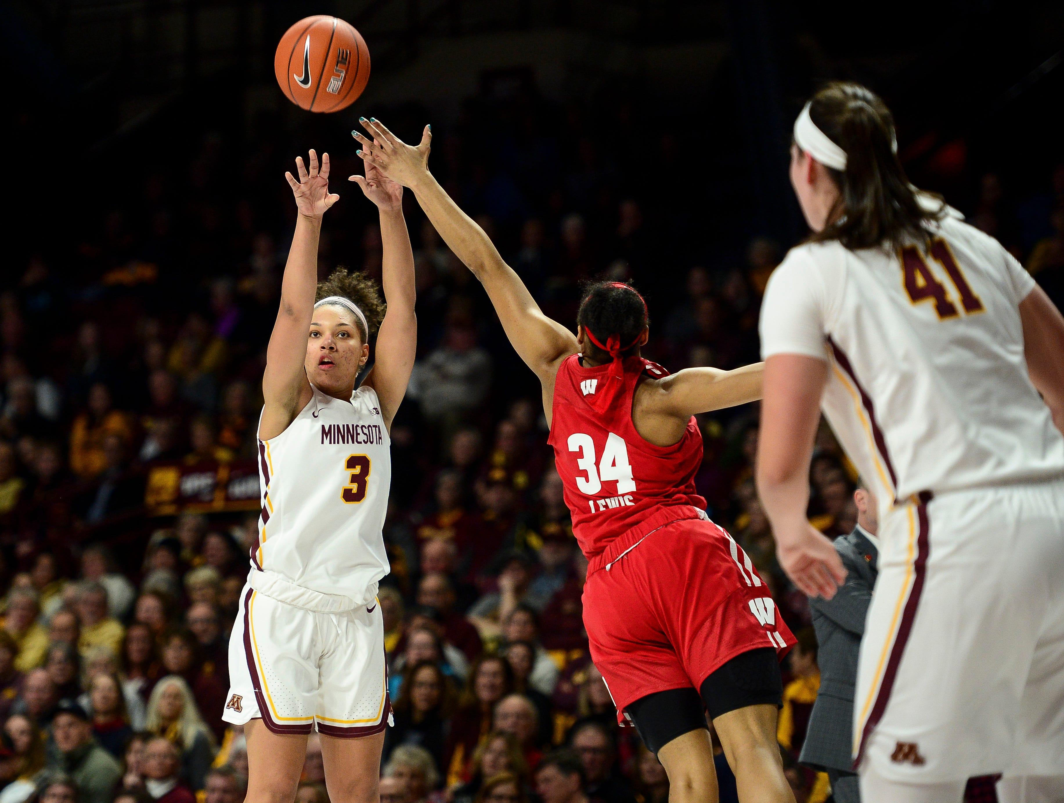 Lamke's 20 helps No. 12 Minnesota top Wisconsin 74-56