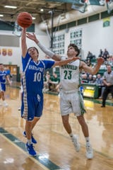 Harper Creek at Pennfield in boys basketball in Interstate 8 Conference action