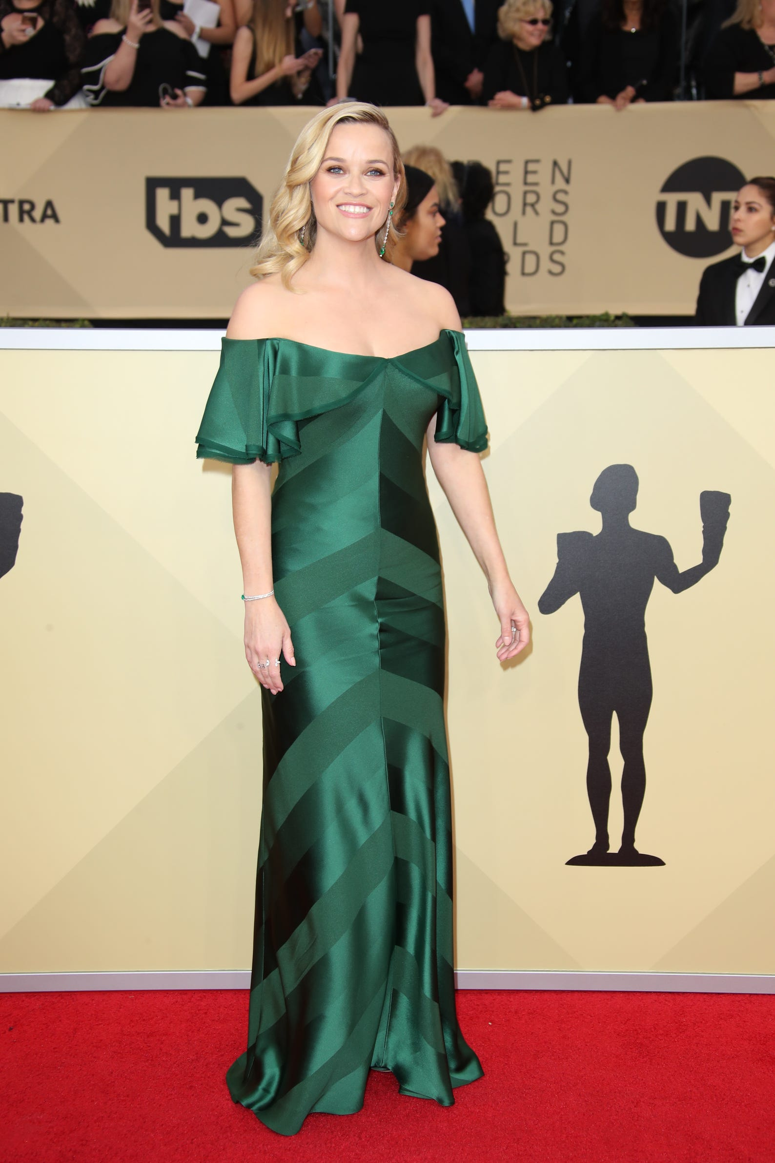 431e01aa94 Reese Witherspoon looked chic in an off-the-shoulder emerald gown by Zac  Posen