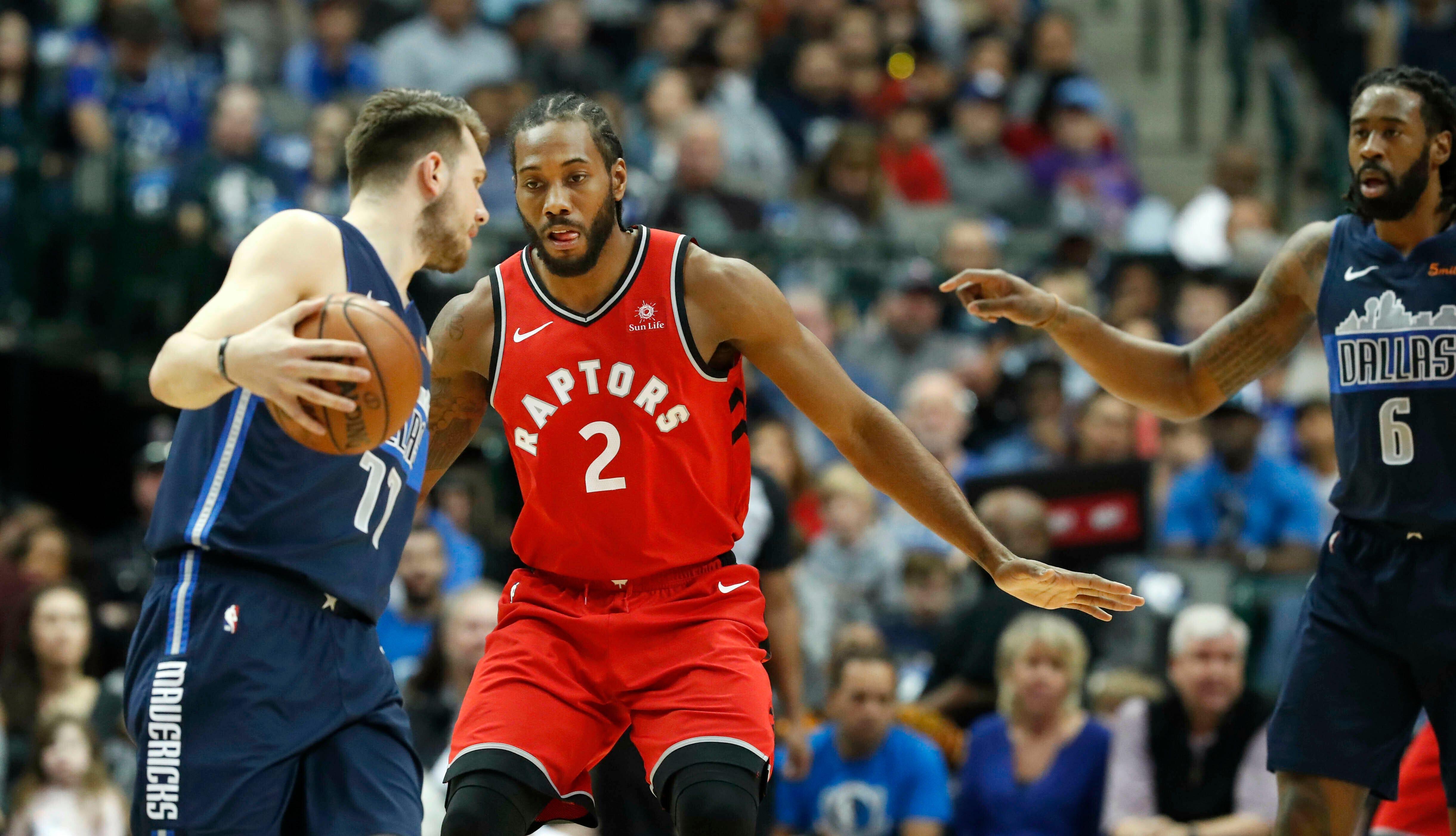 Leonard scores 33 as Raptors beat Doncic, Mavericks 123-120