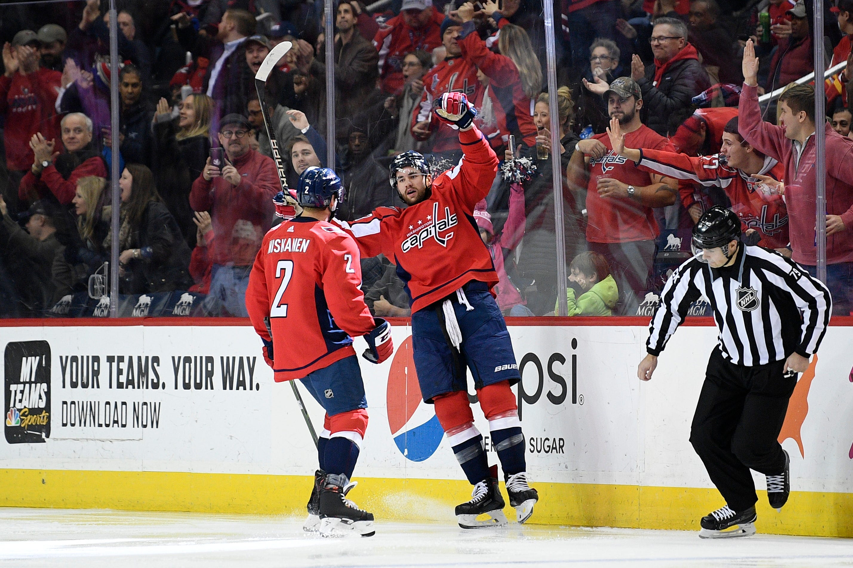 Capitals beat Flames 4-3 without Ovechkin to end 7-game skid
