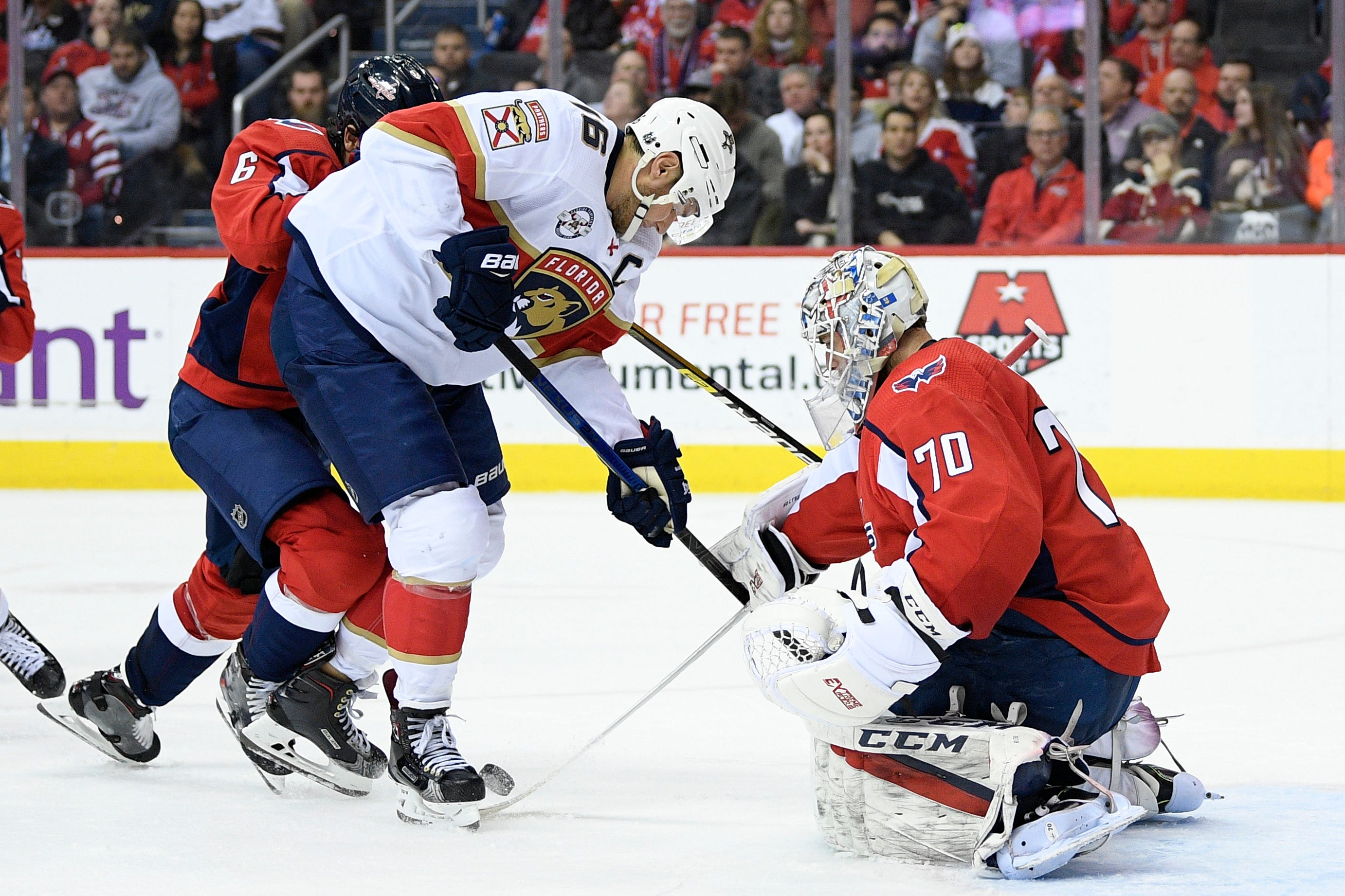Hoffman scores in OT, Panthers beat Capitals 5-4
