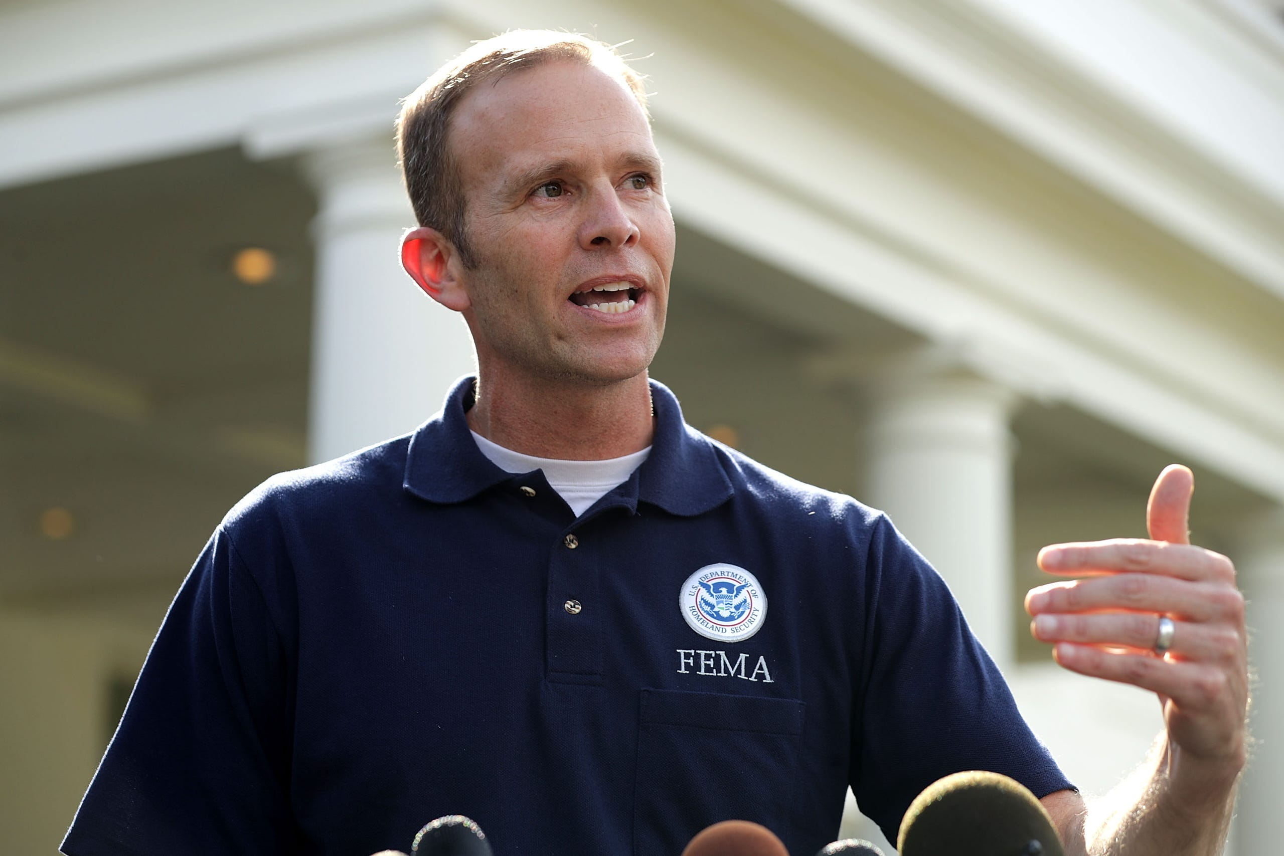 Federal Emergency Management Agency Administrator Brock Long talks to reporters outside the West Wing of the White House Sept. 26, 2017 in Washington. Long, who drew praise and criticism for his agency's response to major disasters, including Hurricane Maria, is leaving the agency.