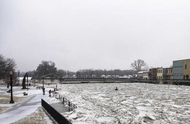 This Wednesday, Feb. 6, 2019 photo shows a view of downtown Portland, Mich., and the ice jam in the Grand River. About 50 people were evacuated due to flooding.