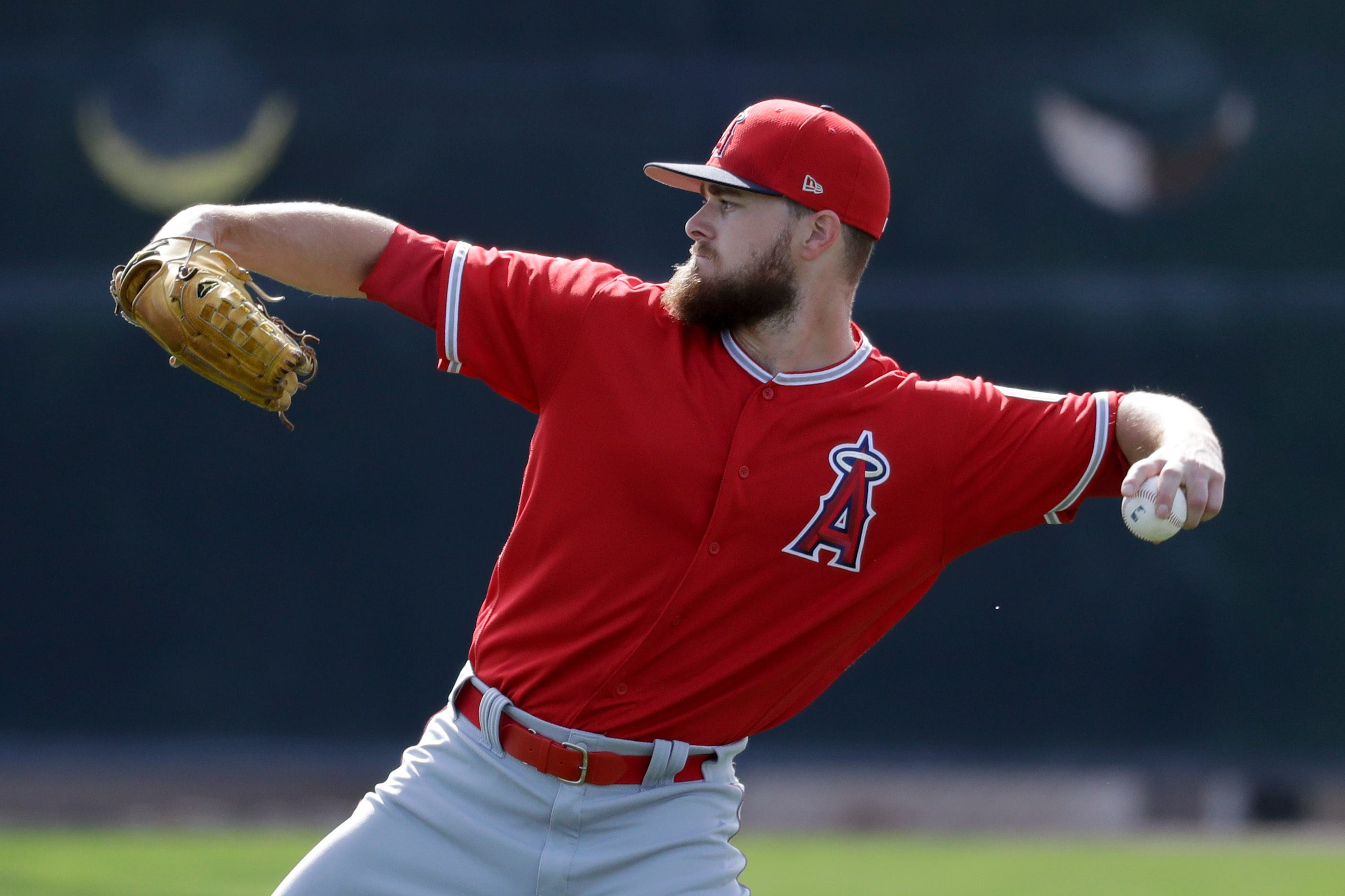 Angels add another two-way player for spring training