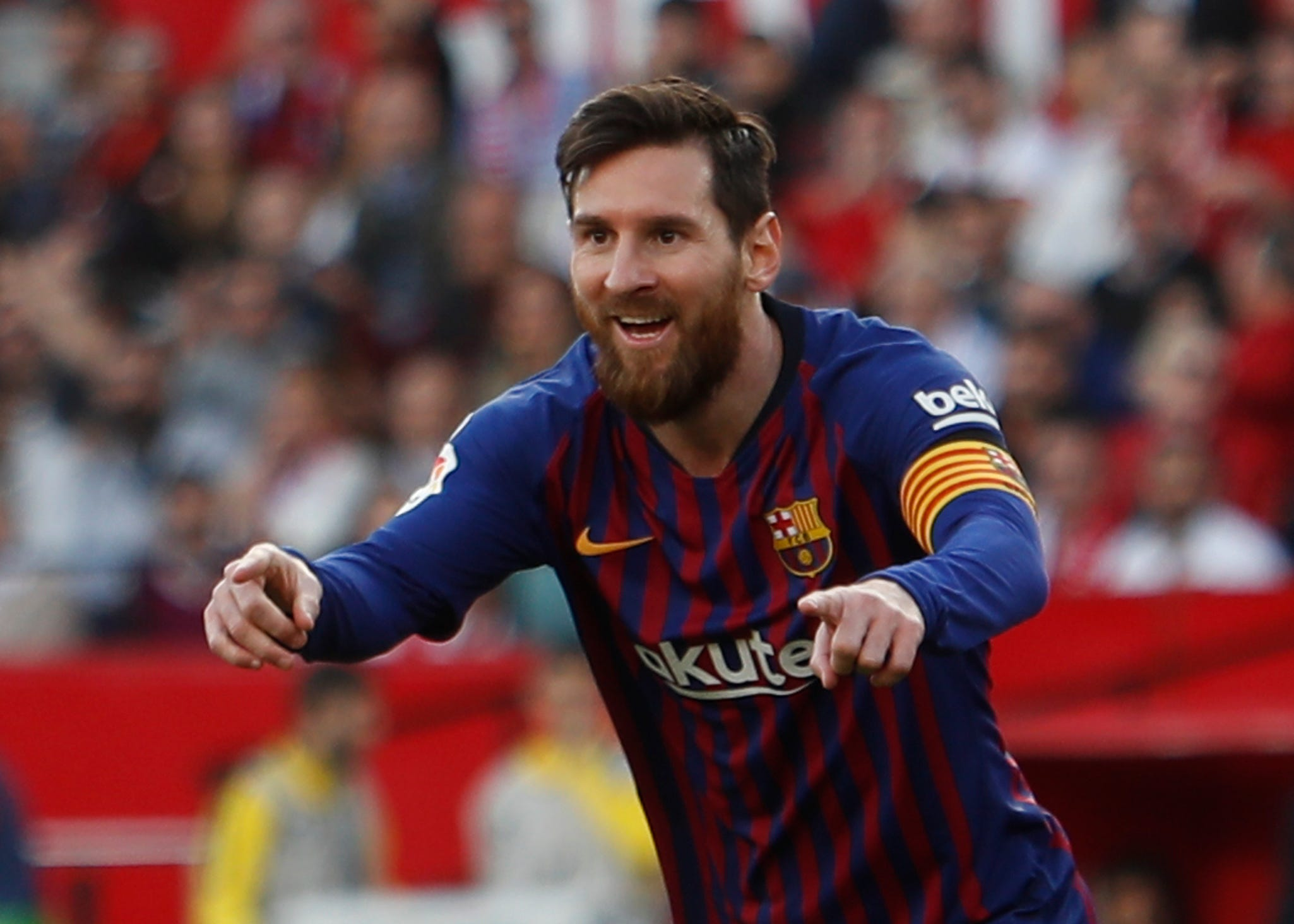 Messi scores 50th hat trick to give Barca 4-2 win at Sevilla