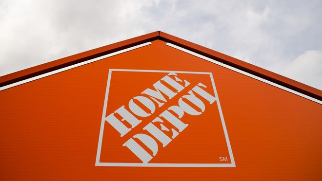 A file photo shows a sign for Home Depot.