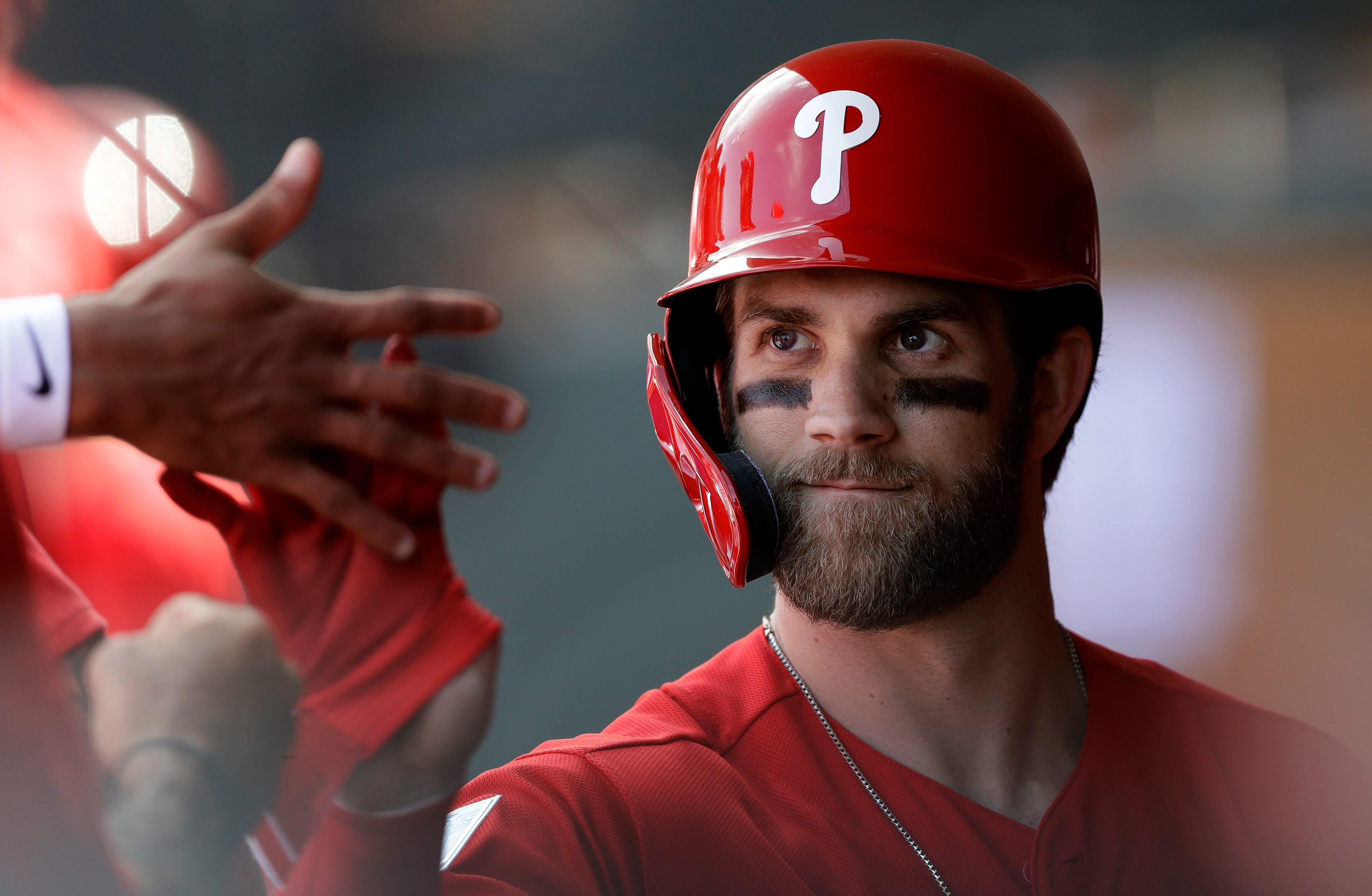 Phillies star Harper hit by 96 mph pitch in ankle, limps off