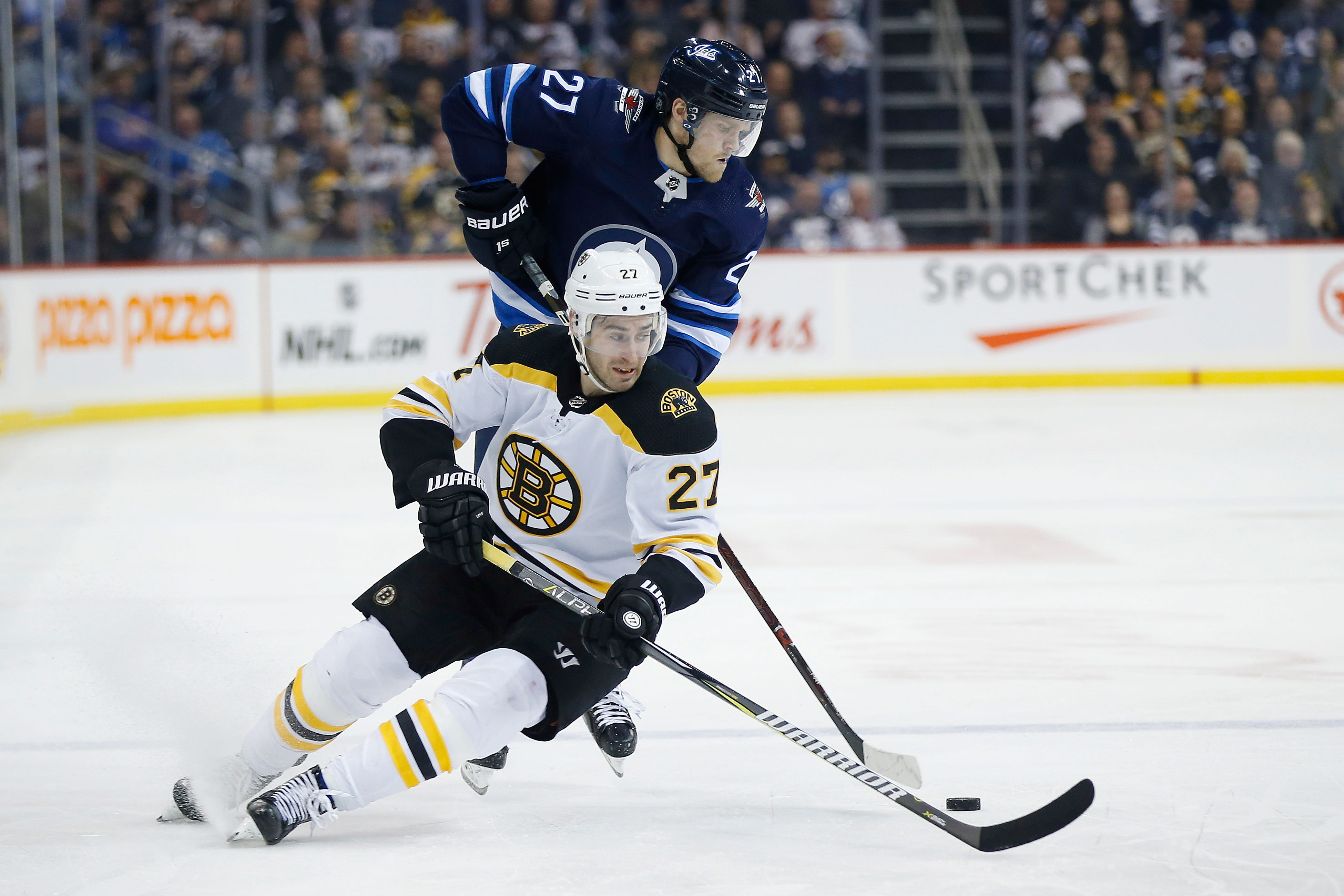 Scheifele has goal, 2 assists as Jets beat Bruins 4-3