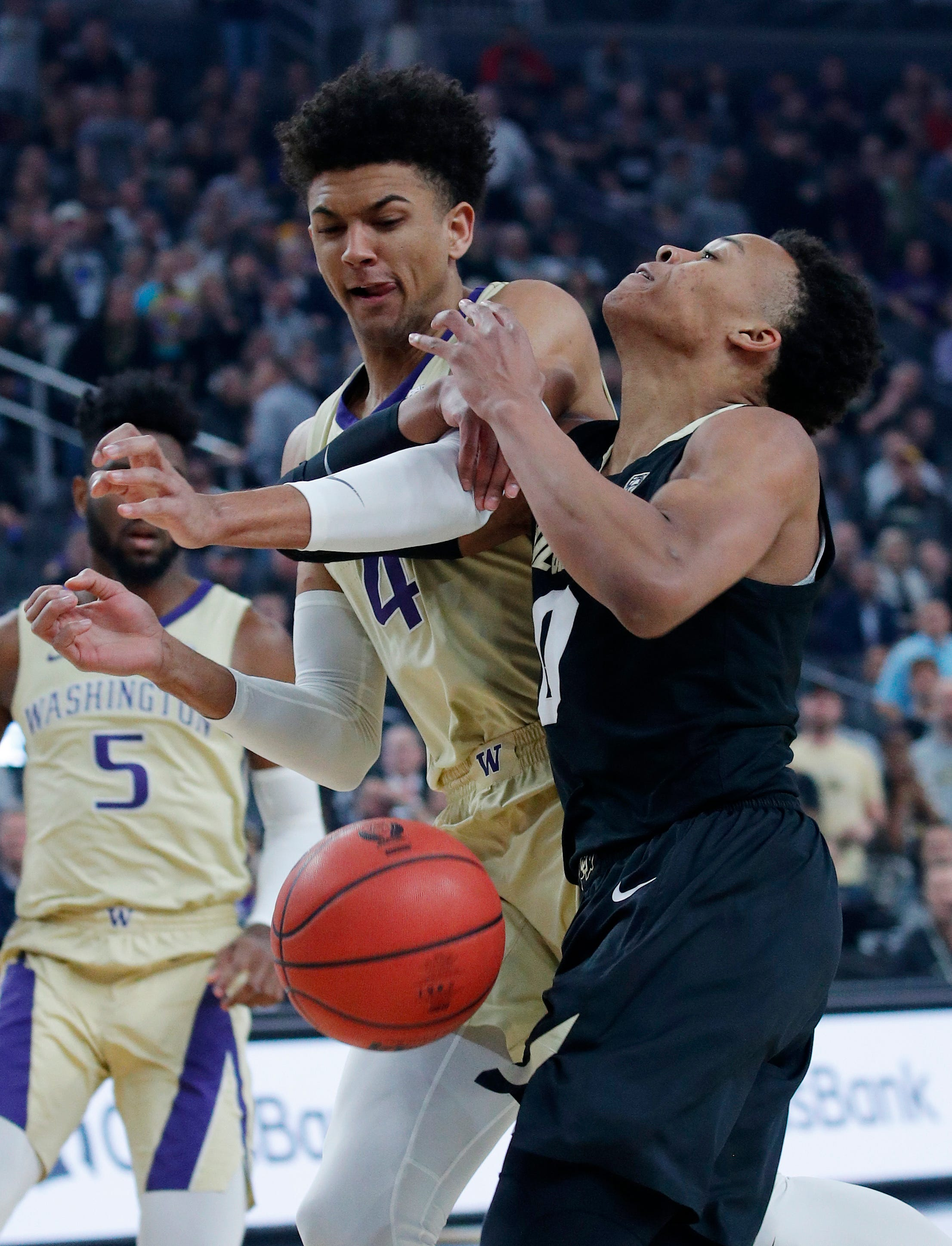 Washington holds off Colorado 66-61 in Pac-12 semifinals
