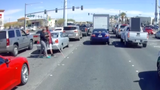 She walked into the middle of traffic to help a man she didn't know.