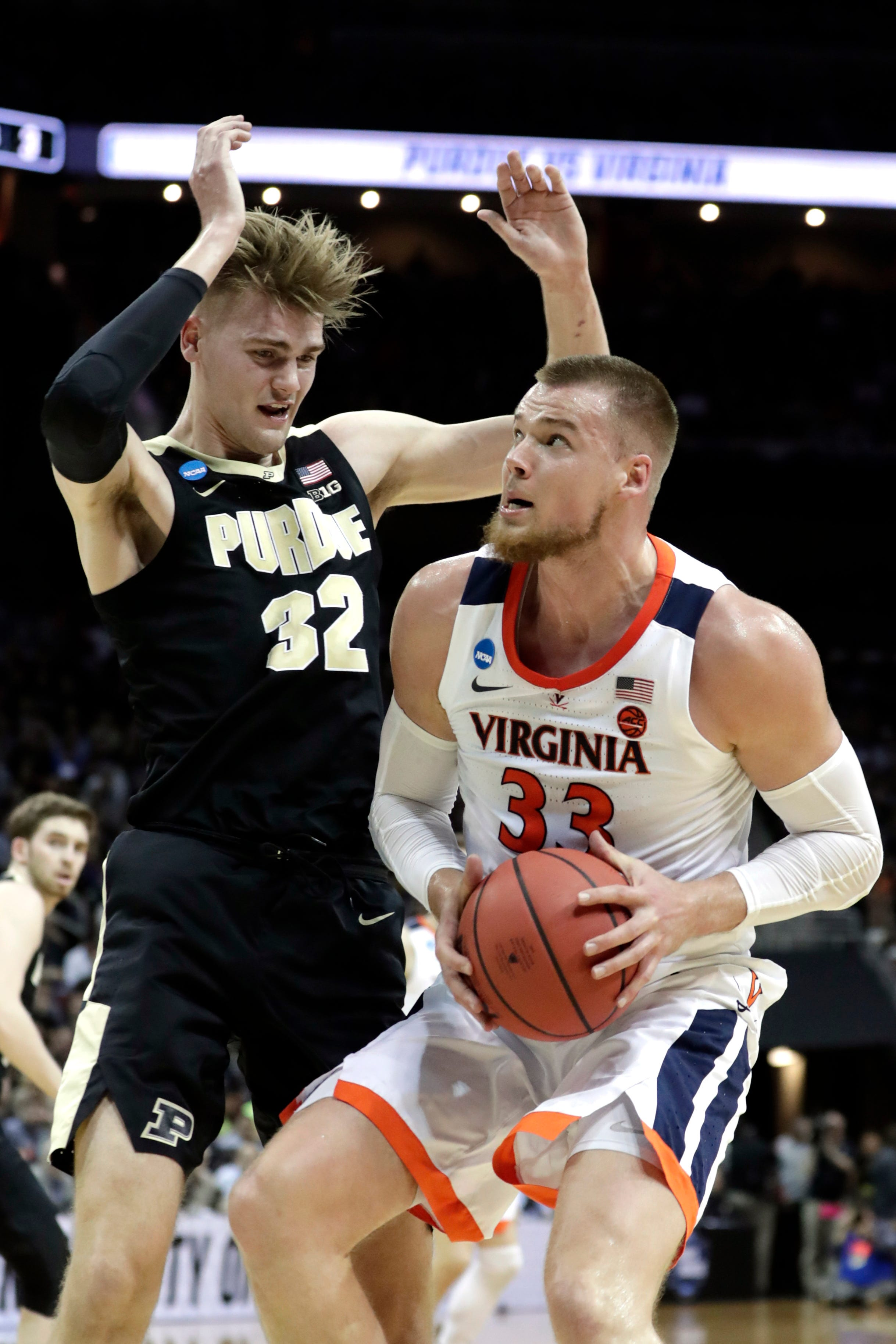 Virginia shakes off Purdue 80-75 in OT to win South Region