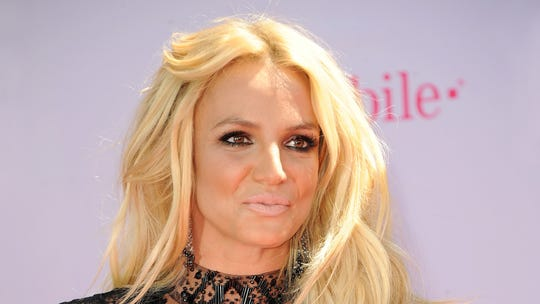 Britney Spears rolls in the sand, shows off bikini bod on Caribbean vacation