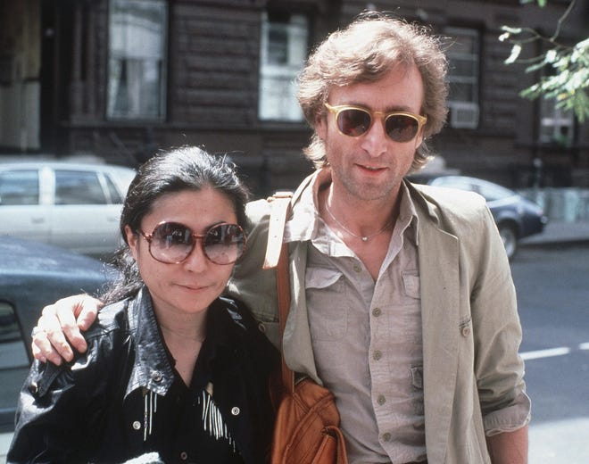 John Lennon, right, and his wife Yoko Ono in New York City on Aug. 22, 1980.