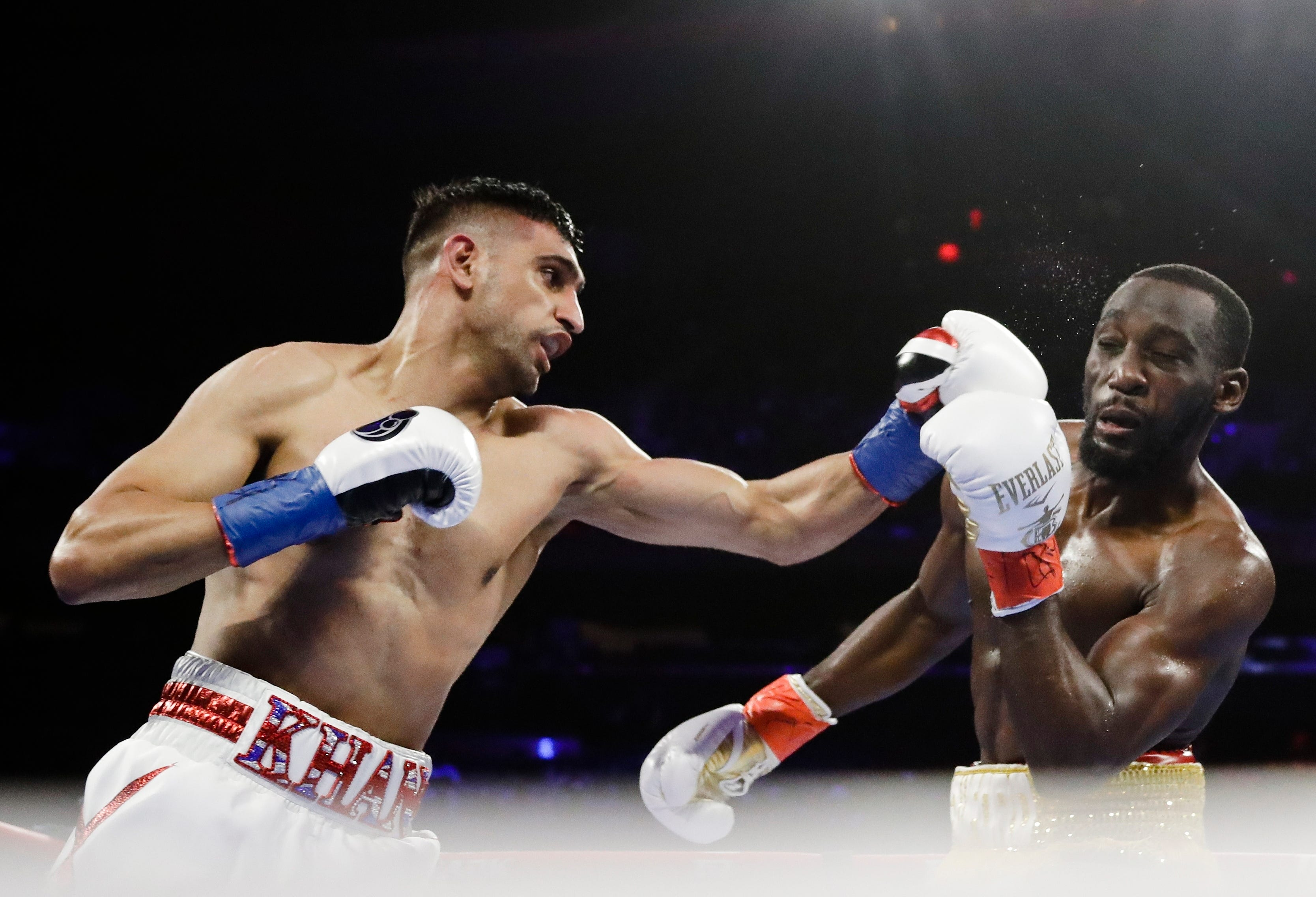 Crawford wins by TKO when Khan doesn't go on after low blow