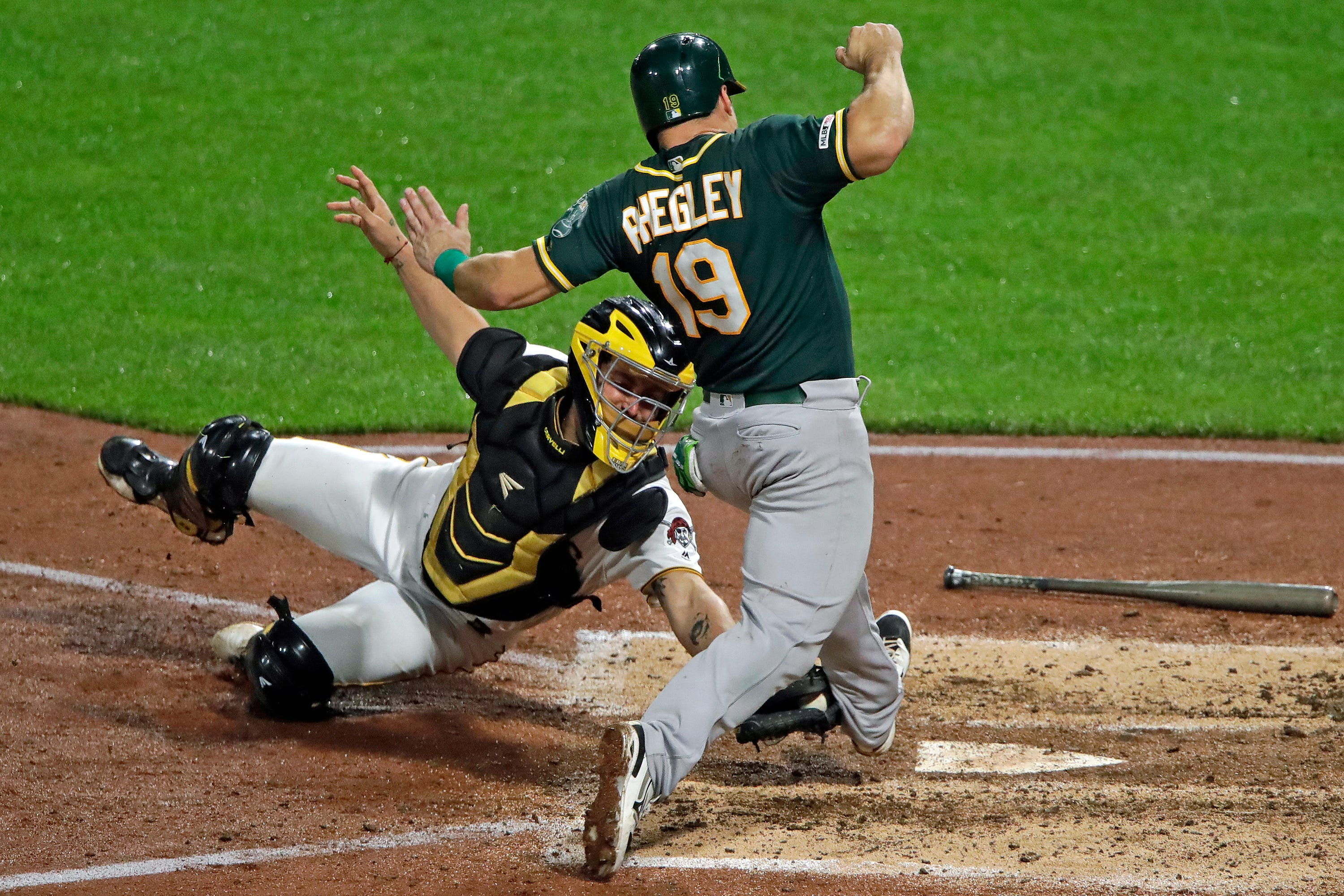 Phegley drives in 8, A's rip Pirates 14-1 to end 6-game skid