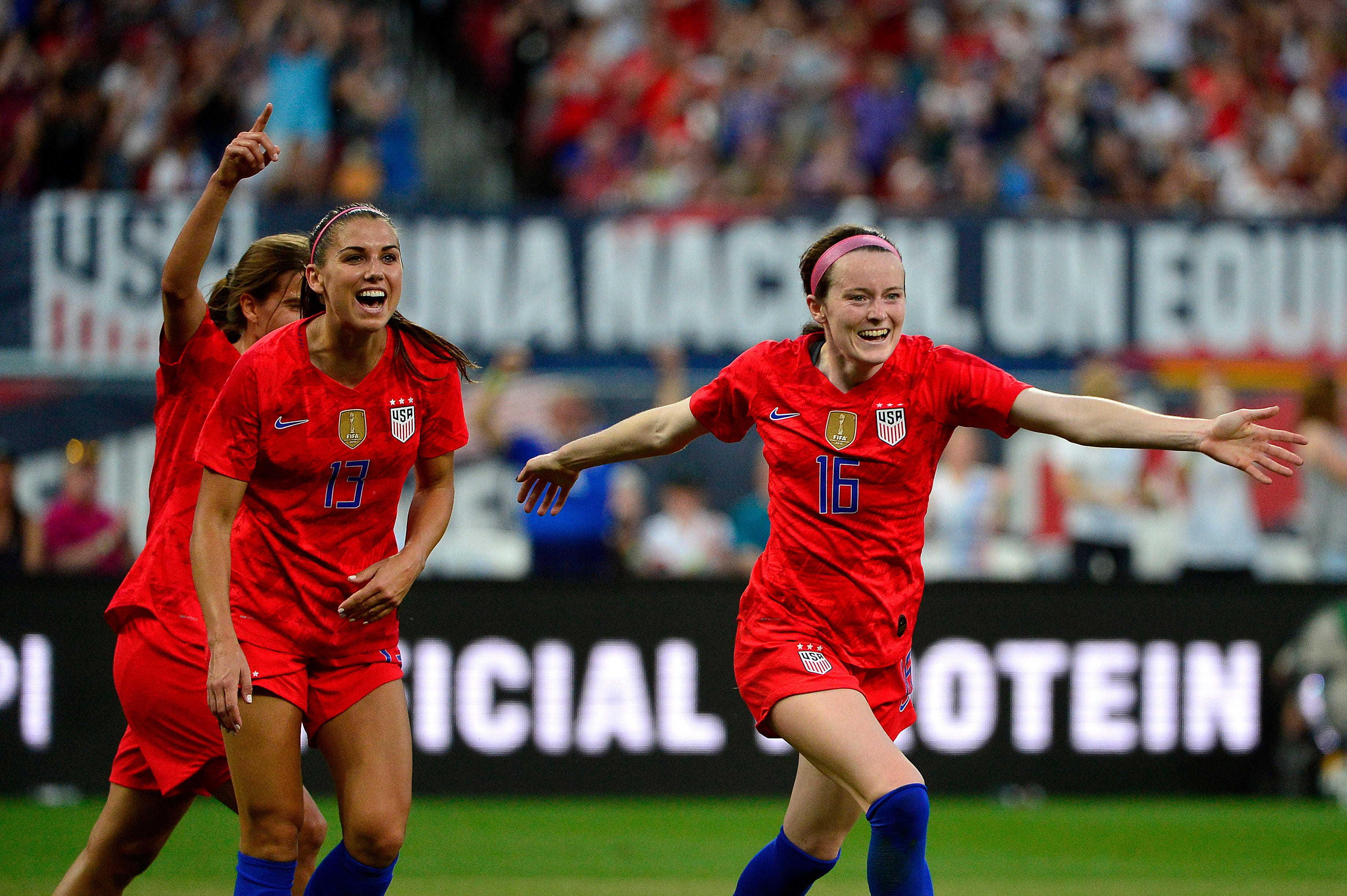 May 16, 2019; St. Louis , MO, USA; USA midfielder Rose Lavelle (16) celebrates with forward Alex Morgan (13) and forward Tobin Heath (17) after scoring against New Zealand goalkeeper Erin Nayler (not pictured) in the first half during a Countdown to the Cup Women's Soccer match at Busch Stadium. Mandatory Credit: Jeff Curry-USA TODAY Sports