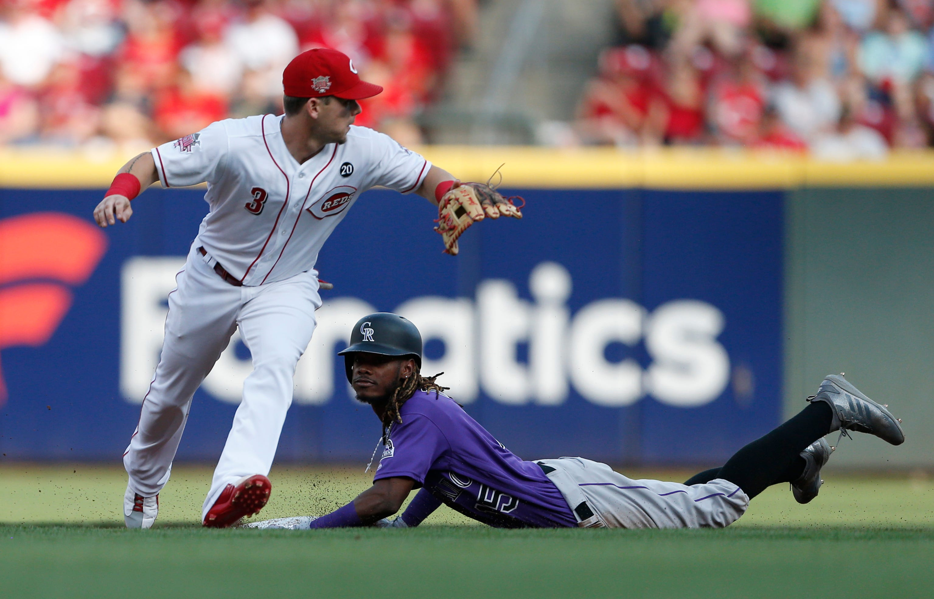 Murphy ties career high with 6 RBIs, Rockies rout Reds 12-2 thumbnail