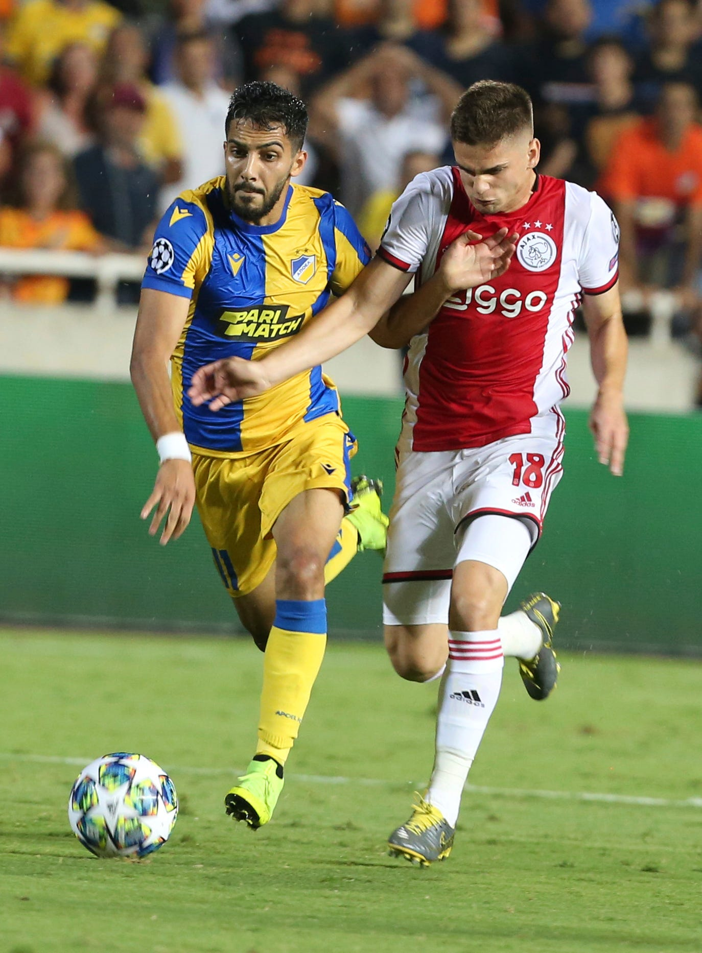 10-men Ajax struggles to draw in Champions League qualifying