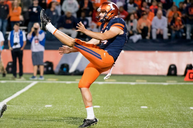 Illinois punter Blake Hayes (14) pulled off a memorable fake punt on Saturday during the Illini's 41-24 victory against Nebraska.