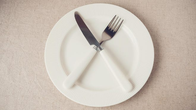 """Intermittent fasting   The term """"intermittent fasting"""" can mean various things, among them eating only one meal a day, restricting calorie intake substantially for two or three days a week (typically 500 calories for women, 600 for men), or following such eating patterns as 16:8 (condensing all the day's food consumption into one eight-hour period and avoiding food for the other 16). The practice is thought to induce weight loss, lower the risk of developing type 2 diabetes, and even help prevent cancer, among other health benefits. Though people have fasted for eons -- whether for reasons of health or religion or simply because enough food wasn't available -- but the modern-day trend began in England in 2010 and reached America several years later."""