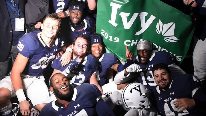 Yale players celebrate winning the Ivy League after their 50-43 double overtime victory against Harvard in an NCAA college football game at the Yale Bowl, Saturday, Nov. 23, 2019, in New Haven, Conn. (Arnold Gold/New Haven Register via AP)