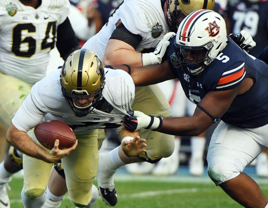 Dec 28, 2018; Nashville, TN, USA; Purdue Boilermakers quarterback David Blough is sacked by Auburn Tigers defensive lineman Derrick Brown during the first half in the 2018 Music City Bowl at Nissan Stadium.