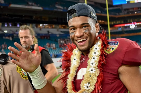 Alabama quarterback Tua Tagovailoa celebrates after defeating Oklahoma in the College Football Playoff semifinal game at the Orange Bowl at Hard Rock Stadium in Miami Gardens, Fla. on Dec. 29, 2018.