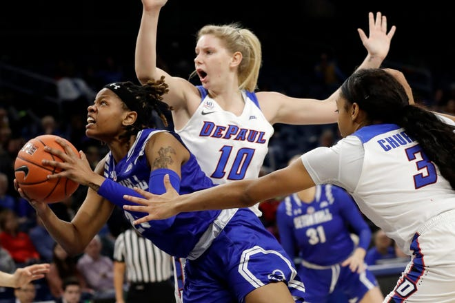 Desiree Elmore squeezes through DePaul defenders during Seton Hall's semifinal matchup at the Big East tournament.