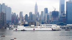 Navy Hospital Ship USNS Comfort travels up the Hudson River as it heads to Pier 90 as the coronavirus pandemic continues to overwhelm medical infrastructure Monday. Docked on the West Side of Manhattan, the hospital ship will provide another thousand beds for non-COVID-19 patients.