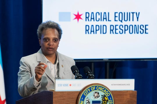 Mayor Lori Lightfoot answers a reporter's question during a news conference to provide an update to the latest efforts by the Racial Equity Rapid Response Team in Chicago on Monday.