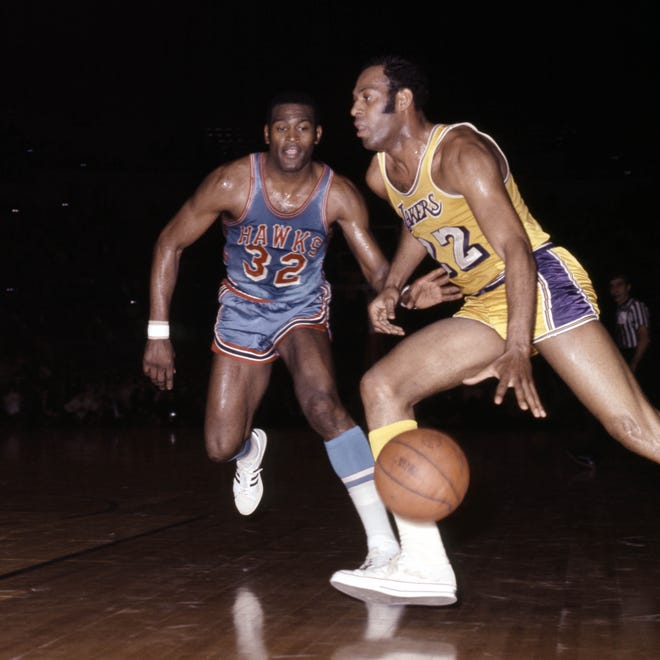 This file photo shows Atlanta Hawks forward Bill Bridges (32) defending Los Angeles Lakers guard Elgin Baylor (22) at The Forum in Los Angeles.