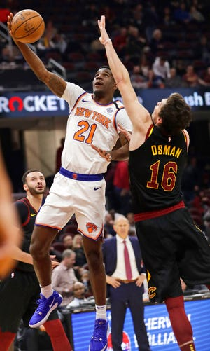 The New York Knicks' Damyean Dotson drives to the basket against the Cavaliers' Cedi Osman in a game in a game in January.