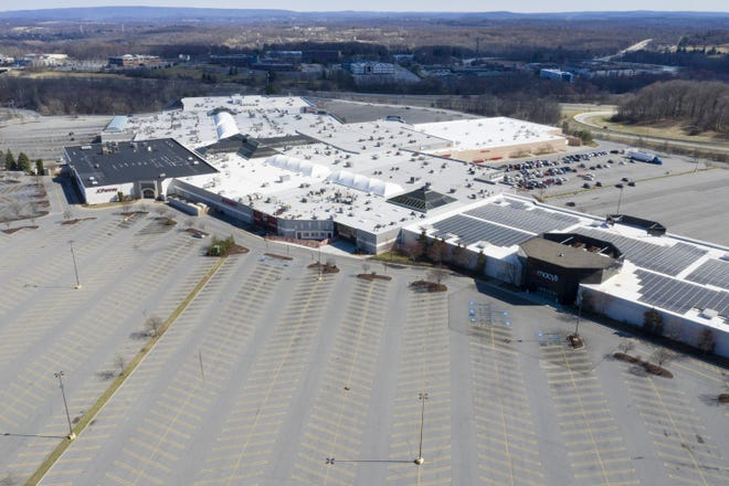 Empty parking lots at the Galleria mall in the Town of Wallkill on March 21.  Local economic development officials and regional bankers were torn on how long the effects of the economic damage might last.