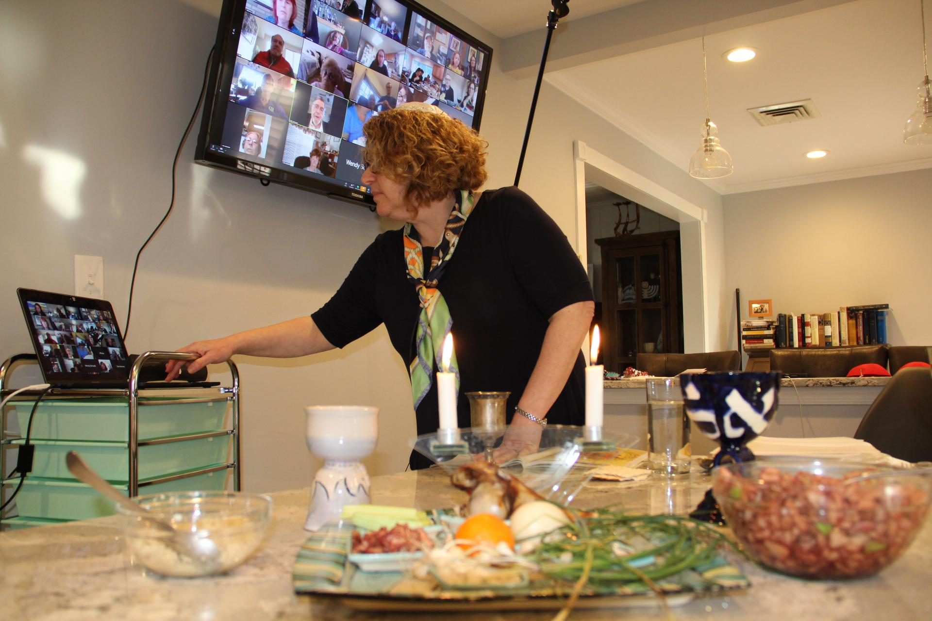With in-person religious services canceled, places of worship turned to Zoom calls and Facebook live broadcasts to connect with the faithful. Here Rabbi Rebecca Shinder, of Temple Beth Shalom in the Village of Florida, joins congregation members in Orange County on Zoom to share the rituals of the Seder meal.