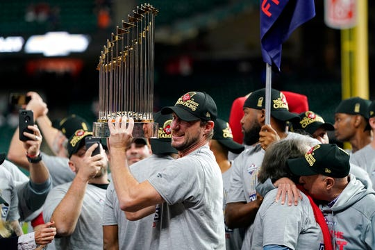 From Oct. 30, 2019, Washington Nationals starting pitcher Max Scherzer celebrates with the trophy after Game 7 of the World Series against the Houston Astros in Houston.