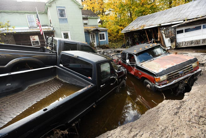 Dozens of vehicles were destroyed from the 2019 Halloween flooding near the East Canada Creek along North Main Street in Dolgeville. Infrastructure, homes and vehicles were completely destroyed and residents were evacuated. Local first responders, neighbors, National Grid and National Guard members were on location to clean up and assess damage.