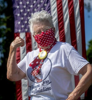 FILE: Mae Krier, 94, of Bristol Township, one of the original Rosie the Riveters, wears one of the face masks she has made during the COVID-19 pandemic.