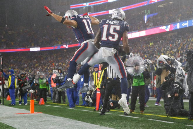 New England Patriots wide receiver Julian Edelman (left) celebrates with wide receiver N'Keal Harry after a touchdown during the first half against the Dallas Cowboys at Gillette Stadium on Nov. 24, 2019. This year, there wasn't much celebrating for Patriots wide receivers.