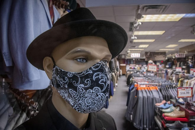 A mask-bedecked mannequin inside Suits To Impress in Randolph Mall sets a good example during the coronavirus epidemic.