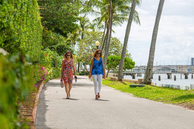 Donna Sprunger and Lucy Cruz of Wellington take a walk on the Lake Trail in March 2020.