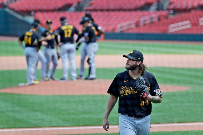 Pittsburgh Pirates starting pitcher Trevor Williams walks off the field after being removed from a game against the St. Louis Cardinals on July 25.