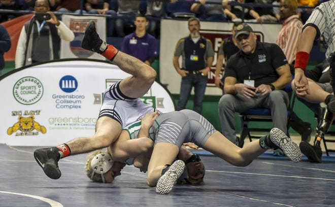 UCA's Heaven Fitch works on getting back points against Robbinsville Luke Wilson in the 1A 106 Championship match at the 2020 NCHSAA Wrestling Championship in the Greensboro Coliseum Saturday. {PJ WARD-BROWN/SPECIAL TO THE COURIER-TRIBUNE]