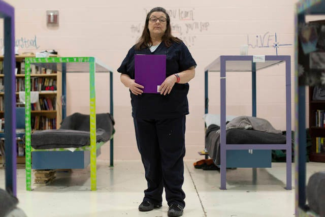 Tammy Tuttle holds a folder of her newly earned program certificates inside the New Life Pod inside the Maury County Jail on Tuesday, Feb, 25, 2020.