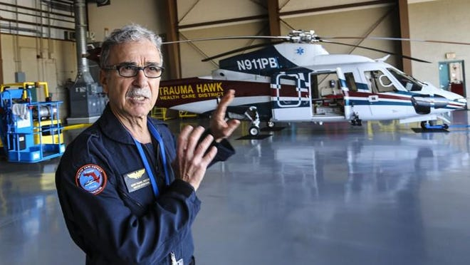 Gerry Pagano, director of aviation operations, at the Trauma Hawk Aeromedical Hangar at Palm Beach International Airport on Friday, Feb. 3, 2017. Behind him is one of the county's two Trauma Hawk helicopters. One of them sustained damage during an incident at the hangar on Tuesday, Aug. 25, 2020. [LANNIS WATERS/palmbeachpost.com]
